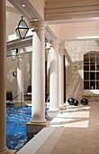 Daylight shot of streaks of light on columns inside an interior poolroom, Bath, United Kingdom