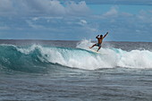 Surfer on breaking wave in Teahupoo surfing area, Tahiti Iti, Tahiti, Windward Islands, French Polynesia, South Pacific