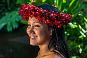 Portrait of a pretty young Tahitian woman with a flower headdress in 'The Water Gardens of Vaipahi' Teva I Uta, Tahiti, Windward Islands, French Polynesia, South Pacific