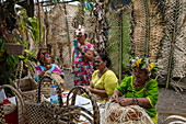 Women demonstrate traditional weaving at a cultural festival, Papeete, Tahiti, Windward Islands, French Polynesia, South Pacific