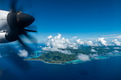 Aerial view with engine of Air Tahiti ATR 72-600 airplane and Moorea Island behind, Moorea, Windward Islands, French Polynesia, South Pacific