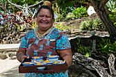 Friendly waitress with tray of ice cream at Sofitel Bora Bora Private Island Resort, Bora Bora, Leeward Islands, French Polynesia, South Pacific