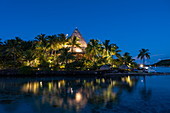 Main building of the Sofitel Bora Bora Private Island Resort in the Bora Bora lagoon at daybreak, Bora Bora, Leeward Islands, French Polynesia, South Pacific