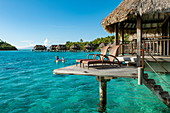 Breakfast is brought in a pirogue outrigger canoe to an overwater bungalow at Sofitel Bora Bora Private Island Resort in Bora Bora Lagoon, Bora Bora, Leeward Islands, French Polynesia, South Pacific