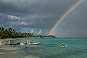 Water sports activities at Sofitel Ia Ora Beach Resort with rainbow over Moorea Lagoon, Moorea, Windward Islands, French Polynesia, South Pacific