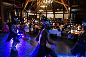 People enjoy Polynesian dancing and cultural performances in the restaurant of the Sofitel Ia Ora Beach Resort, Moorea, Windward Islands, French Polynesia, South Pacific