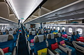 Colorful Moana Premium Economy Class cabin interior on board Air Tahiti Nui Boeing 787 Dreamliner aircraft, Paris Charles de Gaulle Airport (CDG), near Paris, France