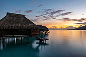 Overwater bungalows at the Hilton Moorea Lagoon Resort & Spa, Moorea, Windward Islands, French Polynesia, South Pacific