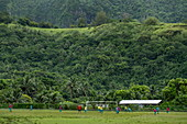 Boys play soccer in Afareaitu, Moorea, Windward Islands, French Polynesia, South Pacific