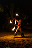 Fire dance during the 'Pacifica' show at the Tiki Village cultural center, Moorea, Windward Islands, French Polynesia, South Pacific