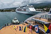 Deck of the passenger cargo ship Aranui 5 (Aranui Cruises) with tug behind it and cruise ship MV Columbus (CMV Cruises) at the pier, Papeete, Tahiti, Windward Islands, French Polynesia, South Pacific