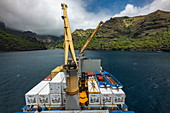 View over the cargo deck with cargo cranes on board the passenger cargo ship Aranui 5 (Aranui Cruises), Hanavave, Fatu Hiva, Marquesas Islands, French Polynesia, South Pacific