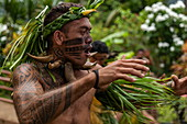 """A Marquesan """"warrior"""" performs a traditional dance at a cultural event for passengers on the Aranui 5 (Aranui Cruises) passenger cargo ship, Hatiheu, Nuku Hiva, Marquesas Islands, French Polynesia, South Pacific"""