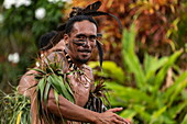 "A Marquesan ""warrior"" performs a traditional dance at a cultural event for passengers on the Aranui 5 (Aranui Cruises) passenger cargo ship, Hatiheu, Nuku Hiva, Marquesas Islands, French Polynesia, South Pacific"