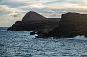 Waves break against coast, Anahehe, Vaipaee Bay, Ua Huka, Marquesas Islands, French Polynesia, South Pacific