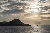 Clouds and coastline at sunset, near Ua Pou, Marquesas Islands, French Polynesia, South Pacific