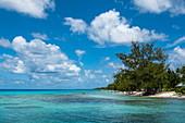 People relaxing on the beach of Avatoru Island, Rangiroa Atoll, Tuamotu Islands, French Polynesia, South Pacific