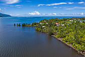 Aerial view of coastline with residential houses, Vaiperetai, Tahiti, Windward Islands, French Polynesia, South Pacific