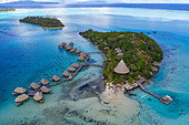 Aerial view of Sofitel Bora Bora Private Island Resort with overwater bungalows in Bora Bora Lagoon, Vaitape, Bora Bora, Leeward Islands, French Polynesia, South Pacific
