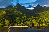 Aerial view of Linareva Beach Resort with trees, lush vegetation and mountains behind, Teniutaoto, Moorea, Windward Islands, French Polynesia, South Pacific