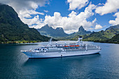 Aerial view of cruise ship MS Astor (Transocean Cruises) in Opunohu Bay, Moorea, Windward Islands, French Polynesia, South Pacific