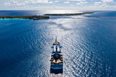 Aerial view of the Aranui 5 (Aranui Cruises) passenger freighter at anchor in the lagoon, Avatoru Island, Rangiroa Atoll, Tuamotu Islands, French Polynesia, South Pacific