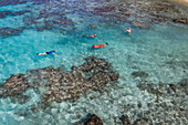 Aerial view of people snorkeling while snorkeling in the lagoon, Avatoru Island, Rangiroa Atoll, Tuamotu Islands, French Polynesia, South Pacific