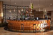 Bartender greets guests with a friendly gesture at Pullman Nadi Bay Resort