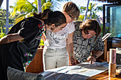 People look at map of the Fijian Islands during their stay at Six Senses Fiji Resort, Malolo Island, Mamanuca Group, Fiji Islands, South Pacific