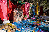 Smiling woman with handicrafts and pareo towels for sale at a souvenir stand on the beach, Sawa-i-Lau Island, Yasawa Group, Fiji Islands, South Pacific