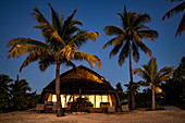 Beach bungalow and coconut trees at the Fiji Marriott Resort Momi Bay at daybreak, Momi Bay, Coral Coast, Viti Levu, Fiji Islands, South Pacific