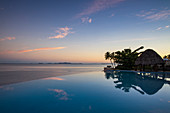 Infinity pool at the Fiji Marriott Resort Momi Bay with a view of the Mamanuca archipelago, Coral Coast, Viti Levu, Fiji Islands, South Pacific