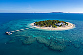 Aerial view of people on SUP stand up paddle boards at Malamala Island Beach Club, Mala Mala Island, Mamanuca Group, Fiji Islands, South Pacific