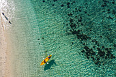 Aerial view of two people in kayak at Malamala Island Beach Club, Mala Mala Island, Mamanuca Group, Fiji Islands, South Pacific
