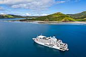 Aerial view of cruise ship MV Reef Endeavor (Captain Cook Cruises Fiji) in roadstead, Gunu, Naviti Island, Yasawa Group, Fiji Islands, South Pacific