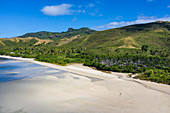 Aerial view of beach at low tide with village behind, Gunu, Naviti Island, Yasawa Group, Fiji Islands, South Pacific