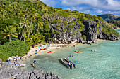 Aerial view of passengers of the cruise ship MV Reef Endeavor (Captain Cook Cruises Fiji) relaxing and enjoying water sports activities on Blue Lagoon Beach, Sawa-i-Lau Island, Yasawa Group, Fiji Islands, South Pacific