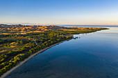 Aerial view of beach and coast at sunrise, Momi Bay, Coral Coast, Viti Levu, Fiji Islands, South Pacific