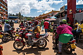 Lively scene with motorcycle taxis in front of the Kimironko Market, Kigali, Kigali Province, Rwanda, Africa