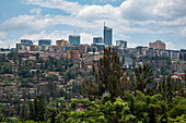 City skyline with trees in the foreground viewed from the gardens of the Kigali Genocide Memorial Center, Kigali, Kigali Province, Rwanda, Africa