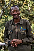 Smiling ranger guide on Canopy Walkway, Nyungwe Forest National Park, Western Province, Rwanda, Africa