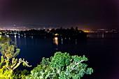View from Emeraude Kivu Resort to Lake Kivu and the city of Bukavu in the Democratic Republic of the Congo in the distance at night, Cyangugu, Kamembe, Western Province, Rwanda, Africa