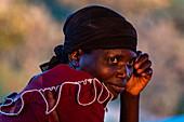 Portrait of a thoughtful looking Rwandan woman in late afternoon light, Kinunu, Western Province, Rwanda, Africa