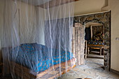Bed with mosquito net in room at the Kivu Paradis Hotel Resort on the banks of Lake Kivu, Nyamyumba, Western Province, Rwanda, Africa