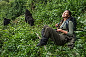 Young woman smiles in sheer joy during a trekking excursion to the Sabyinyo group of gorillas, Volcanoes National Park, Northern Province, Rwanda, Africa