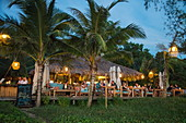 People enjoying drinks in the restaurant and bar of the Mango Bay Resort on Ong Lang Beach at dusk, Ong Lang, Phu Quoc Island, Kien Giang, Vietnam, Asia