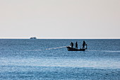 Silhouette of fishermen on boat, Ong Lang, Phu Quoc Island, Kien Giang, Vietnam, Asia