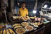 Happy seller of street food, Duong Dong, Phu Quoc Island, Kien Giang, Vietnam, Asia