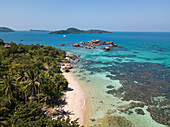 Aerial view of rock formation and beach with coconut palms, Dam Ngang Island, near Phu Quoc Island, Kien Giang, Vietnam, Asia