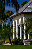 Columned facade of a colonial style house in a tropical setting, in Antigua, West Indies